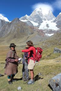 Val distributing solar lights on a trek in Peru