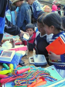 Distributing school supplies provided by LED in Peru