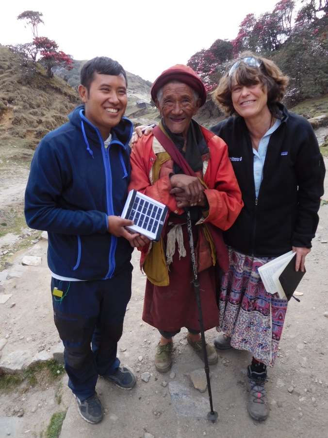 Solukhumbu Trek April/May 2016 - Chhiring and Val, with an elderly monk receiving his LED light, Bhulbhule